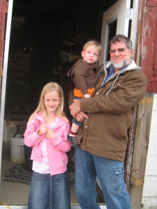 Levi and his grandkids on the farm.